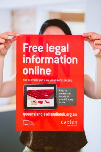 Link to Legal information page- image of woman holding poster