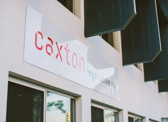 The Caxton Legal Centre building with the sign