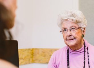 An elderly client of Caxton legal centre receiving advice