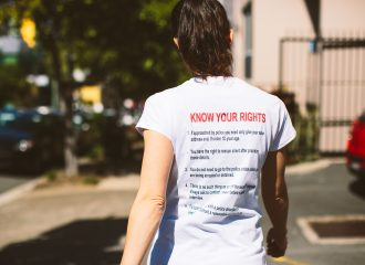 caxton staff member wearing a 'Know your rights' t-shirt