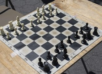 a chess board missing the king and queen